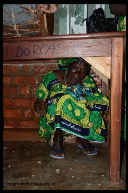A congolese woman taking shelter from the the hail.
